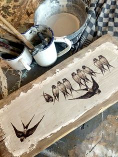 DIY Swallow Sign. She found an old piece of wood, and added some plaster to the surface.