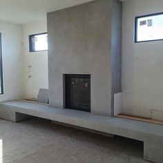 Venetian plaster over old brick fireplace gives a modern