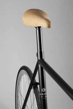 Cork saddle... I'm not convinced. I don't think it would be durable, and I'm not sure it would work in the rain.