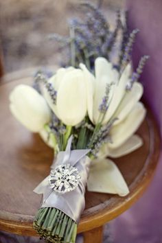 Lavender and tulips with ribbon bridal bouquet! So beautiful, so autumn.   I love tulips in bouquets, table decor and pretty much everywhere. In South Africa tulips are found predominantly in April, one of our biggest wedding months locally. Visit my website and www.fb.com/labolaweddings for more info and ideas  fashionbride.files.wordpress.com/2012/12/wedding-bouquet-tulip-4.jpg?w=554