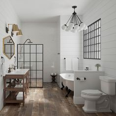 Get the look of hardwood floors without the high maintenance they'd require in a bathroom. This farmhouse modern master ups the rustic-chic factor with wood-look tile floors.