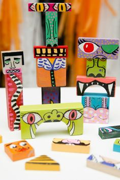 Recycle the kid's old wooden blocks into a fun new Halloween toy with these colorful painted DIY make your own monster blocks.