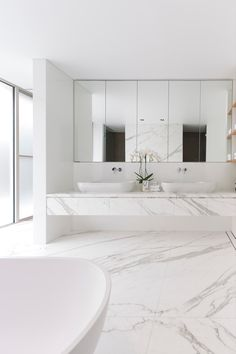 all stone, floating vanity with vessel sinks with wall mounting fittings, wall of mirror