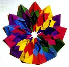 Origami Fireworks by Yami Yamauchi Folded from 12 squares of duo paper by Gilad Aharoni on www.giladorigami.com