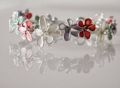 I have never thought we can create some magical looking flowers with some nail polish. These DIY spring nail polish flowers are so petite and lovely. Nail Polish Jewelry, Nail Polish Flowers, Nail Polish Crafts, Homemade Jewelry, Diy Jewelry Making, Wire Crafts, Jewelry Crafts, Diy Rings Easy, Easy Diy