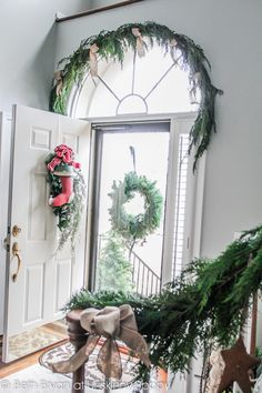 Front door Christmas decor with evergreen swag