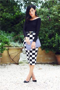 checkered skirt with chevron clutch and black top