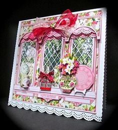 Lilies Triple Arch Window Mini Kit on Craftsuprint designed by Sandie Burchell - made by Cynthia Massey - Reduced the size by 5% , mounted onto white card with bottom punched, used the same punched border in pink for the top of the windows, decoupaged with foam pads, added a birthday present and a co-ordinating bow, to complete I added the matching insert, very quick and easy, a beautiful design with stunning results. - Now available for download!