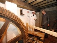Prince Charles about to start mill at Stanway Watermill