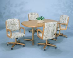 Kitchen Table And Chairs With Wheels casual swivel caster glass top dinette set dinetteonline