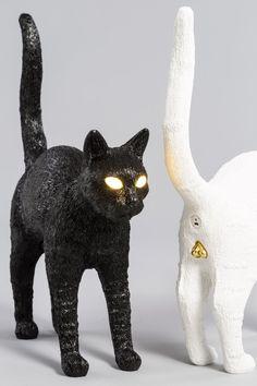 studio job's cat-shaped lamp for seletti has eyes that light up designboom