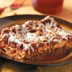 Weekday Lasagna 1 pound lean ground beef (90% lean) 1 small onion, chopped 1 can (28 ounces) crushed tomatoes 1-3/4 cups water 1 can (6 ounces) tomato paste 1 envelope spaghetti sauce mix 1 egg, lightly beaten 2 cups (16 ounces) fat-free cottage cheese 2 tablespoons grated Parmesan cheese 6 uncooked lasagna noodles 1 cup (4 ounces) shredded part-skim mozzarella cheese