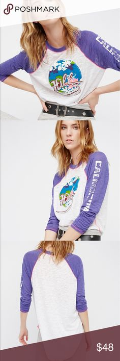 """🌙Free People The Hills Tee Soft and semi-sheer baseball style tee featuring a bright front tropical graphic with an embroidered """"Hills"""" accents. Contrast sleeves with worn 'California"""" lettering along the left sleeve.  66% Polyester 25% Rayon 9% Cotton Measurements for size Small Bust: 42.5"""" = 107.95 cm Length: 27.25"""" = 69.21 cm Sleeve Length: 22.25"""" = 56.51 cm Free People Tops Tees - Long Sleeve"""
