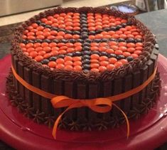 Basketball cake. Chocolate cake, chocolate frosting, kit kats around the outside and Reese's pieces or mms on the top. Cute, also a fun idea for a team party.