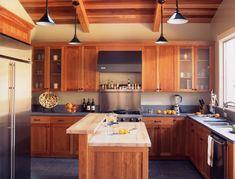 Oak cabinets, grey counters, cream walls