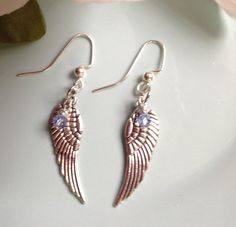 Check out this item in my Etsy shop https://www.etsy.com/listing/207628225/angel-wing-earrings-swarovski-earrings
