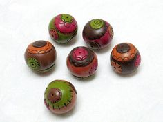 6 round patchwork like multicolor beads by OrlyFuchsGalchen