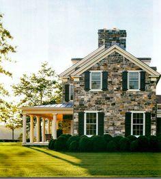 Stone, white trim, black shutters