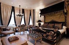 Glamorous master bedroom draperies.
