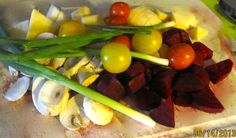 Freshly picked yellow and red cherry tomatoes, green onions, rainbow beets and rutabaga. We added a fresh sprig of rosemary with extra virgin olive oil, wrapped in foil and baked 2o minutes at 400, delicious!
