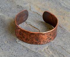"Manipulated with fire and a hammer, copper tubing is used to create this unique metal cuff. Approximately 7"" in length and 1"" wide. Copper has been oxidized to show detail."
