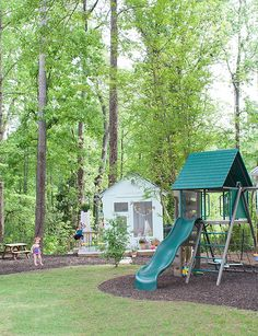 That's rubber mulch you see under the new backyard playset and wood bark mulch elsewhere in this backyard makeover. Joni Lay of Lay Baby Lay has been gradually upgrading her yard for a couple of years now, and it's looking spectacular. See it on The Home Depot Blog. || @laybabylay