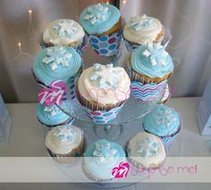 Snowflake topped cupcakes at a Frozen birthday party! See more party planning ideas at CatchMyParty.com!