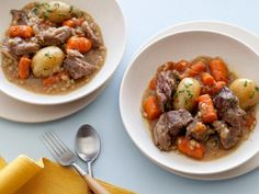 Irish Stew : This comforting stew features tender lamb, hearty carrots and potatoes, all topped off with herb butter.