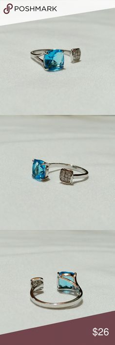 Ocean blue cubic zirconia open ring Stunning open band ring with striking ocean blue crystal and smaller white crystals set together in a square. Rhodium-plated metal with beautiful silver-toned shine. Size 6. Wild Rose Boutique Jewelry Rings