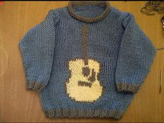 Guitar motif baby sweater using a different pattern as a base. Self-designed guitar shape. (Original pattern used is linked but stripes were omitted.)