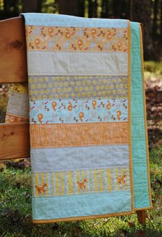Good Natured by Marin Sutton Quilt.  Features woodland animals (fox, deer, squirrels) and nature themed prints