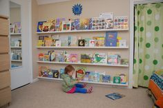 Ikea Ribba picture rails as bookshelves - kids love to see all the books