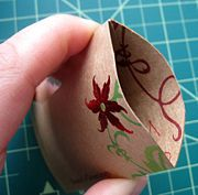How to make small gift pouches from old Christmas cards.