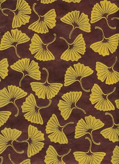 Favorite gingko pattern in yellow on chocolate brown background. This is a yellow ink screen print on a solid dyed lokta paper. Our lokta is handmade in Nepal, sustainably made, supporting local paper