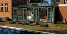 conservatory/poolhouse with folding stacking doors