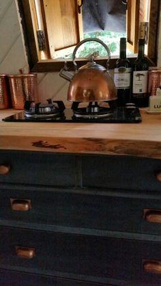 Charity shop chest of drawers painted in Annie Sloan Paris grey and graphite. Waney edge wood worktop. Copper handles. Narrowboat Recalcitrant August 2015