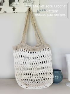 Crochet Bags Market tote crochet pattern Rescued Paw Design - This free crochet tote bag pattern is fun to make and makes a great accessory for the beach! No sand filled bags! This market tote is also good for a trip to a farmers market Bag Crochet, Crochet Market Bag, Crochet Shell Stitch, Crochet Purses, Free Crochet, Crochet Clutch, Crochet Bag Tutorials, Crochet For Beginners, Crochet Patterns