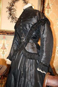 ravensquiffles:  Mourning dress, silk bodice and skirt with black fringe 1867-69 Wikimedia Commons