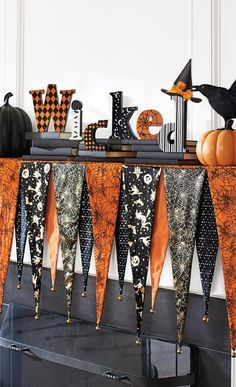 Slip the Bewitching Mantel Scarf over the shelf of your mantel, then top it with your favorite Halloween decorations and create an unforgettable display.
