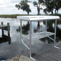 Top built with high quality marine grade UV resistant starboard. All aluminum frame and shelf. 2 leg construction hangs over side of dock giving you more dock space. Outside Measurements: x Fish Cleaning Table, Fish Cleaning Station, Pontoon Boat Accessories, Lakefront Property, Boat Dock, Rustic Design, Grade 1, Marine Products, Boathouse