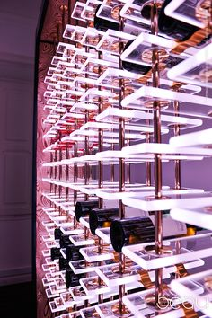 A digital and interactive wine rack incorporating the latest LED technology, made from high quality crystal and specialized aluminium extrusion designed to take the weight of the bottles and to carry power and data to every shelf. Control system by DMX wh…