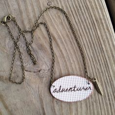 Adventurer Printed Plastic Pendant Necklace with charm #wanderlust #traveler #adventurer #gypsy #feathercharm #leafcharm #triangles #printed #necklace #pendant #adventure #travel #wander