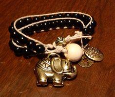 Black and gold hemp wrap elephant charm bracele on Etsy, $13.00