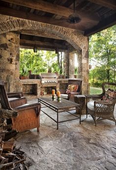 Outdoor kitchen on the covered patio. Love all the stone work.