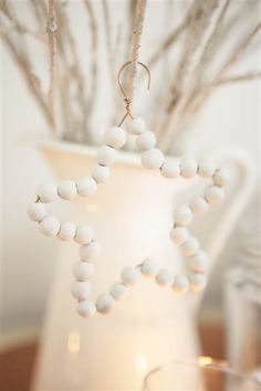 "Dreaming of a white Christmas? Design expert and television personality Tara Dennis was inspired by ""beautifully simple Scandinavian style"" to create this lovely star ornament using just air-dry white clay and 20-gauge copper wire."