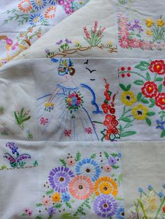 What a lovely quilt made from discarded embroidered tablecloths and pillowcases.