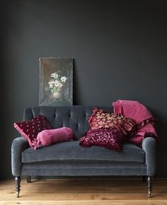 gray couch, colorful pillows