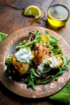 http://cooking.nytimes.com/recipes/1017359-roasted-chicken-with-potatoes-arugula-and-garlic-yogurt