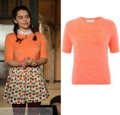 2396ed96c67 Louisa Clark (Emilia Clarke) wears this orange fuzzy eyelash short sleeve  jumper in the movie Me Before You.