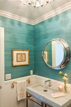 All in the details - beachy bathroom with porthole mirror and rope towel bar. Textured walls with grass cloth wallpaper and beadboard wains...